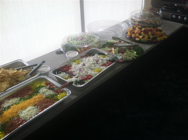A buffet with trays of food and snacks for a special occasion