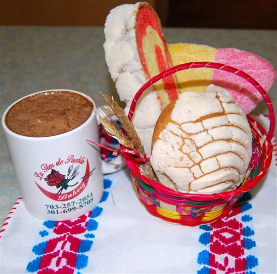 assortment of bakery cookies with a mug of hot chocolate