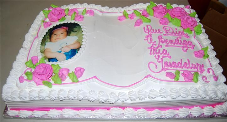 birthday cake with a child photo printed onto the top