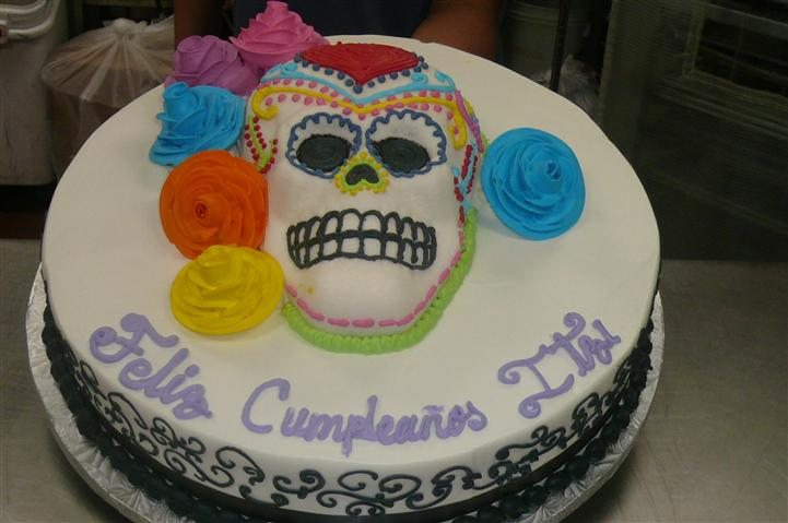 day of the dead cake with skull and flowers