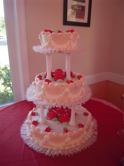 three layer cake with fake edible roses