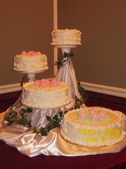 four seperate layer cakes being displayed