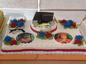 graduation cake with printed photos on top and cap