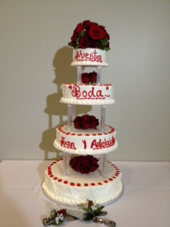 four layer cake with vanilla icing and roses