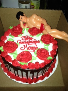 bachelorette cake with almost naked ken doll on top
