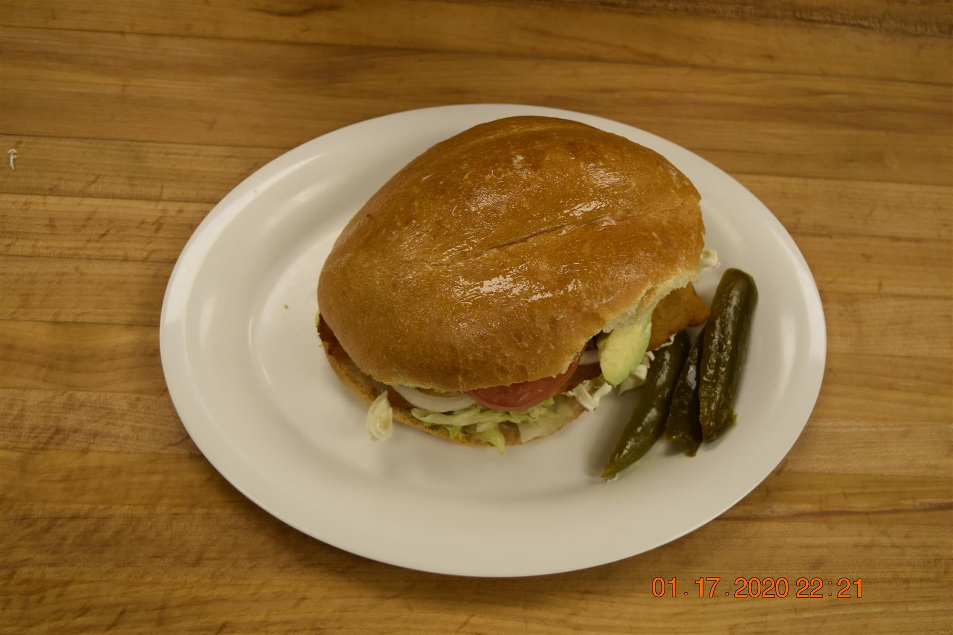 deli sandwich with side of pickles