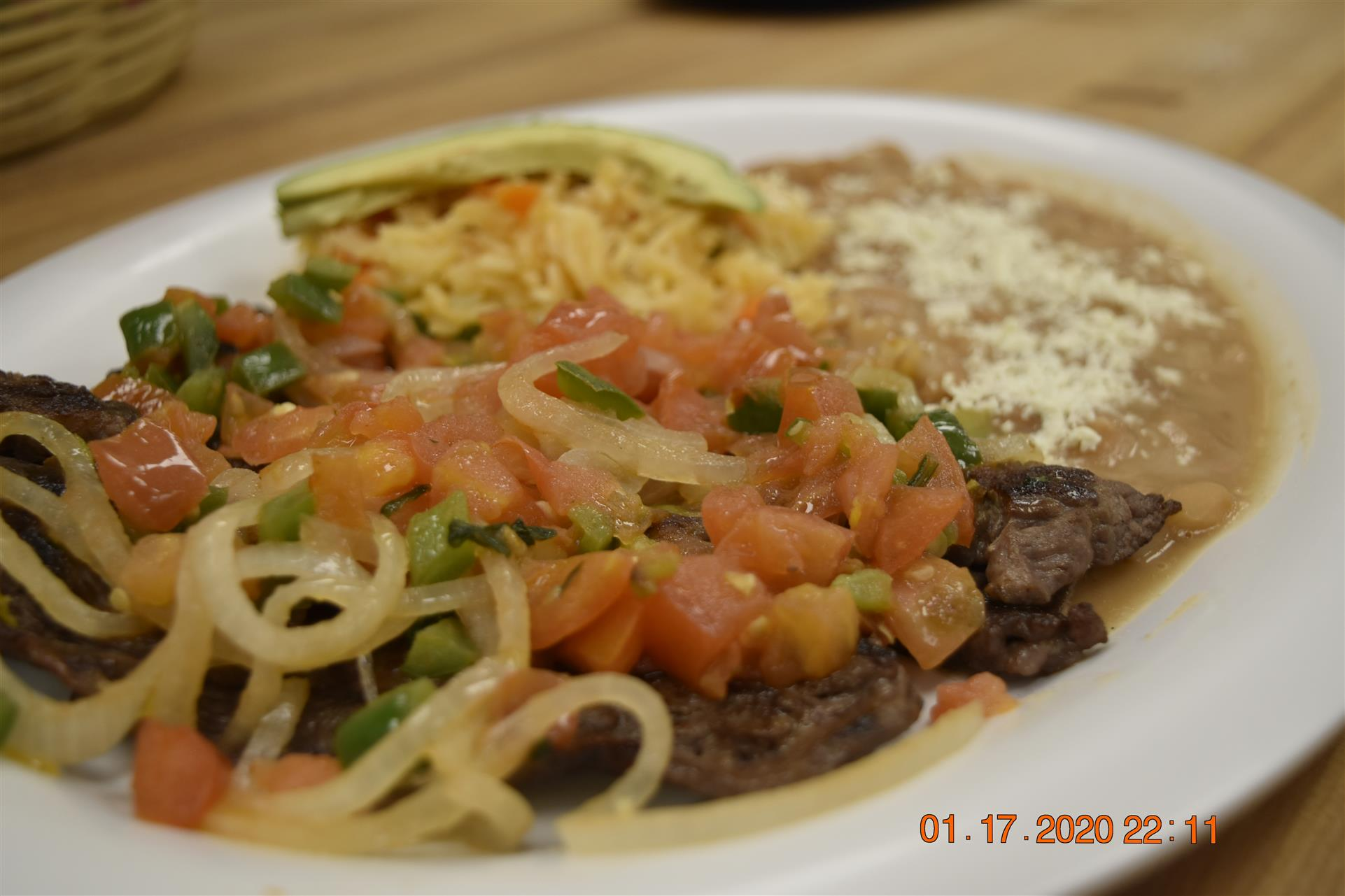 fajita with steak, vegetables and side of beans