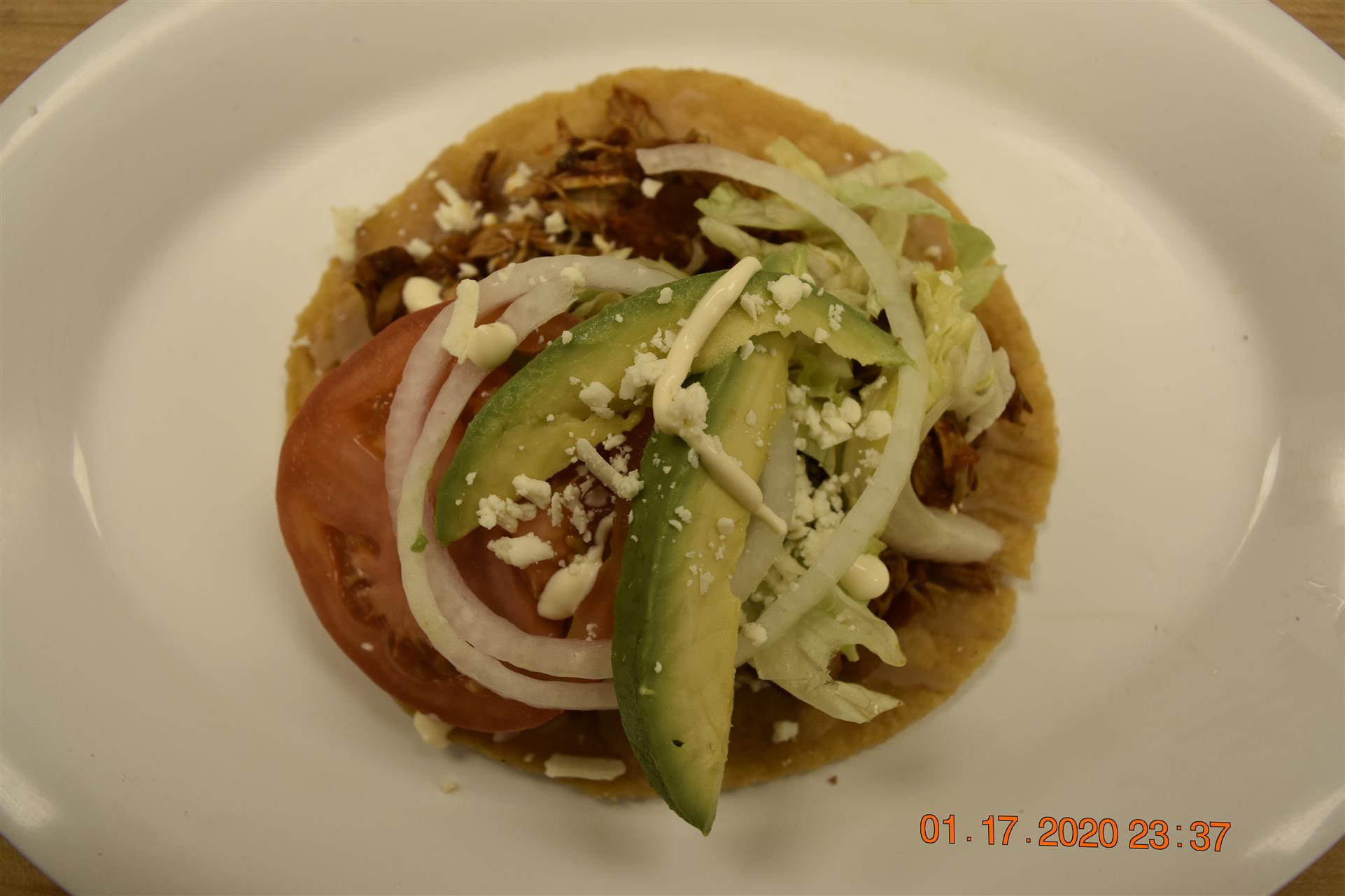tortilla with meat, tomato, onion and avocado