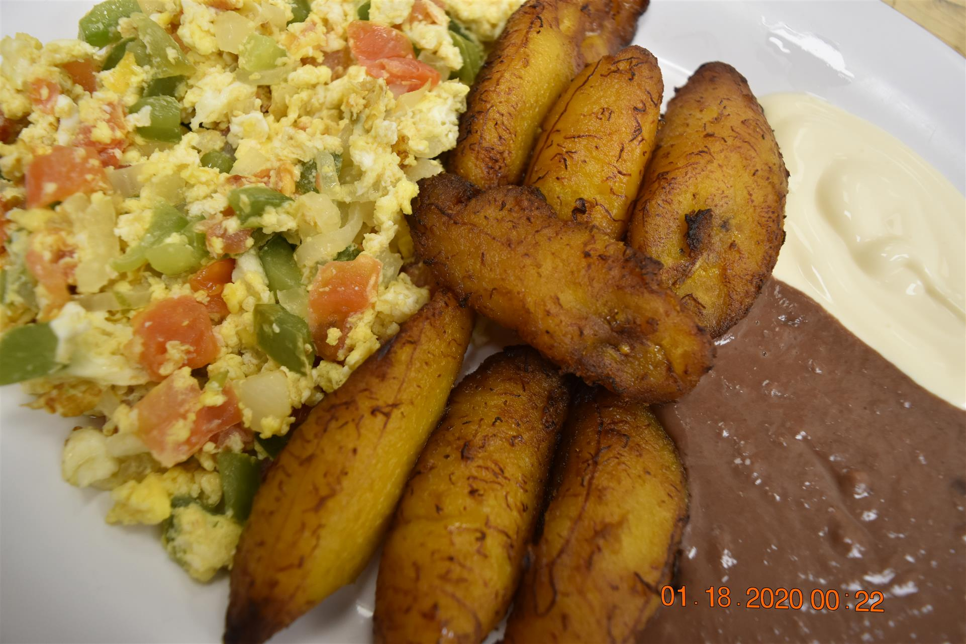 fried plantains with side of rice and beans