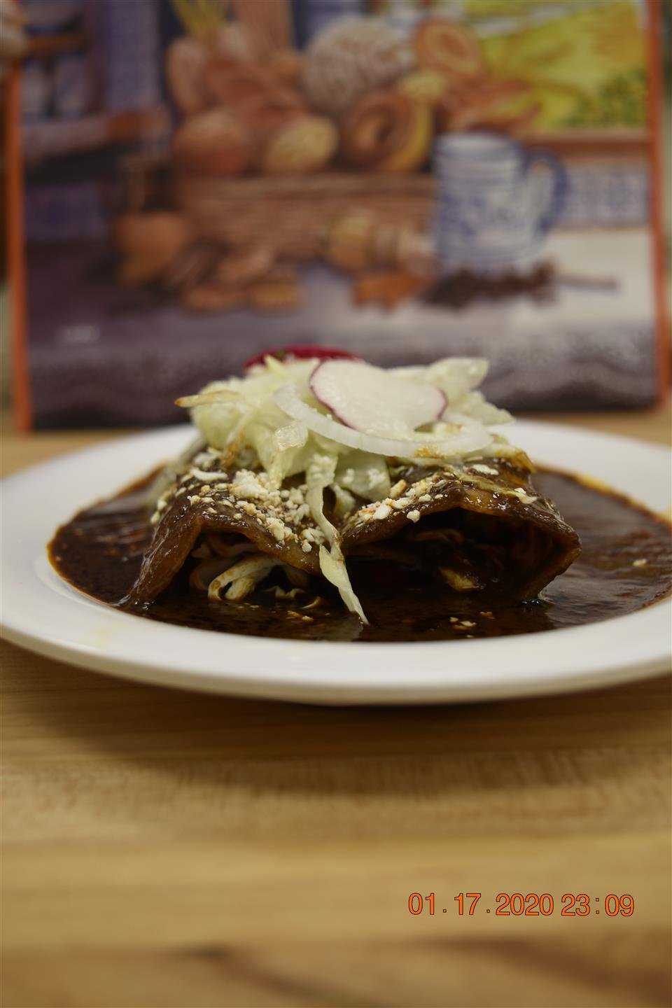 enchilada in a brown sauce