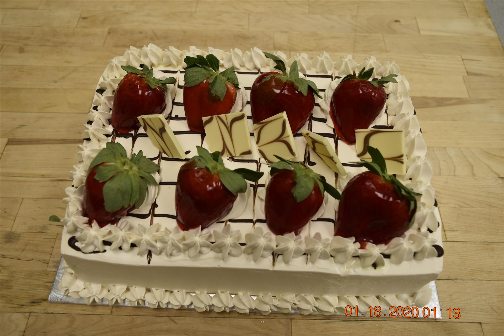 vanilla cake topped with strawberries