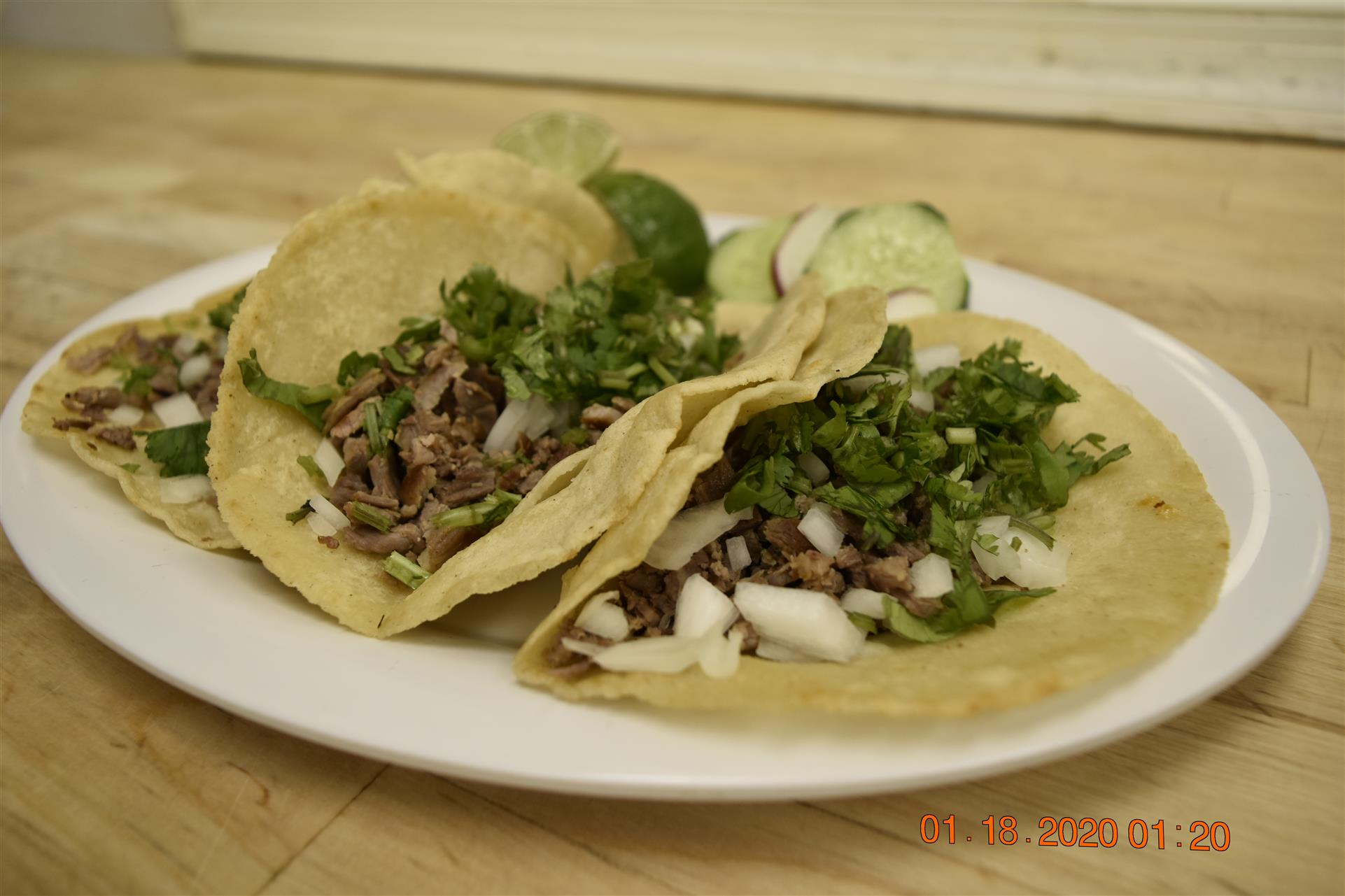 three tortillas with chopped steak and vegetables