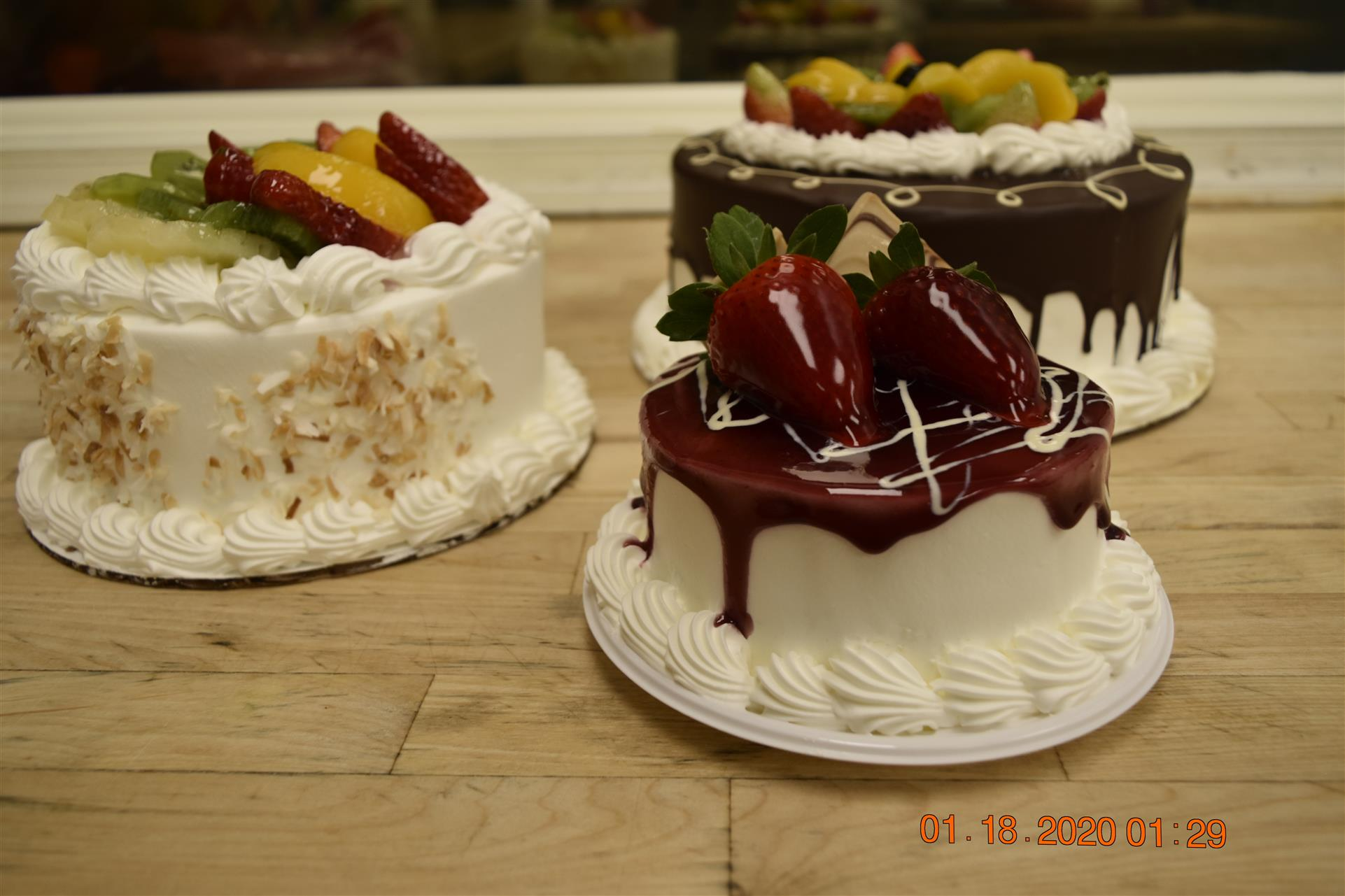 three small cakes with fruit toppings