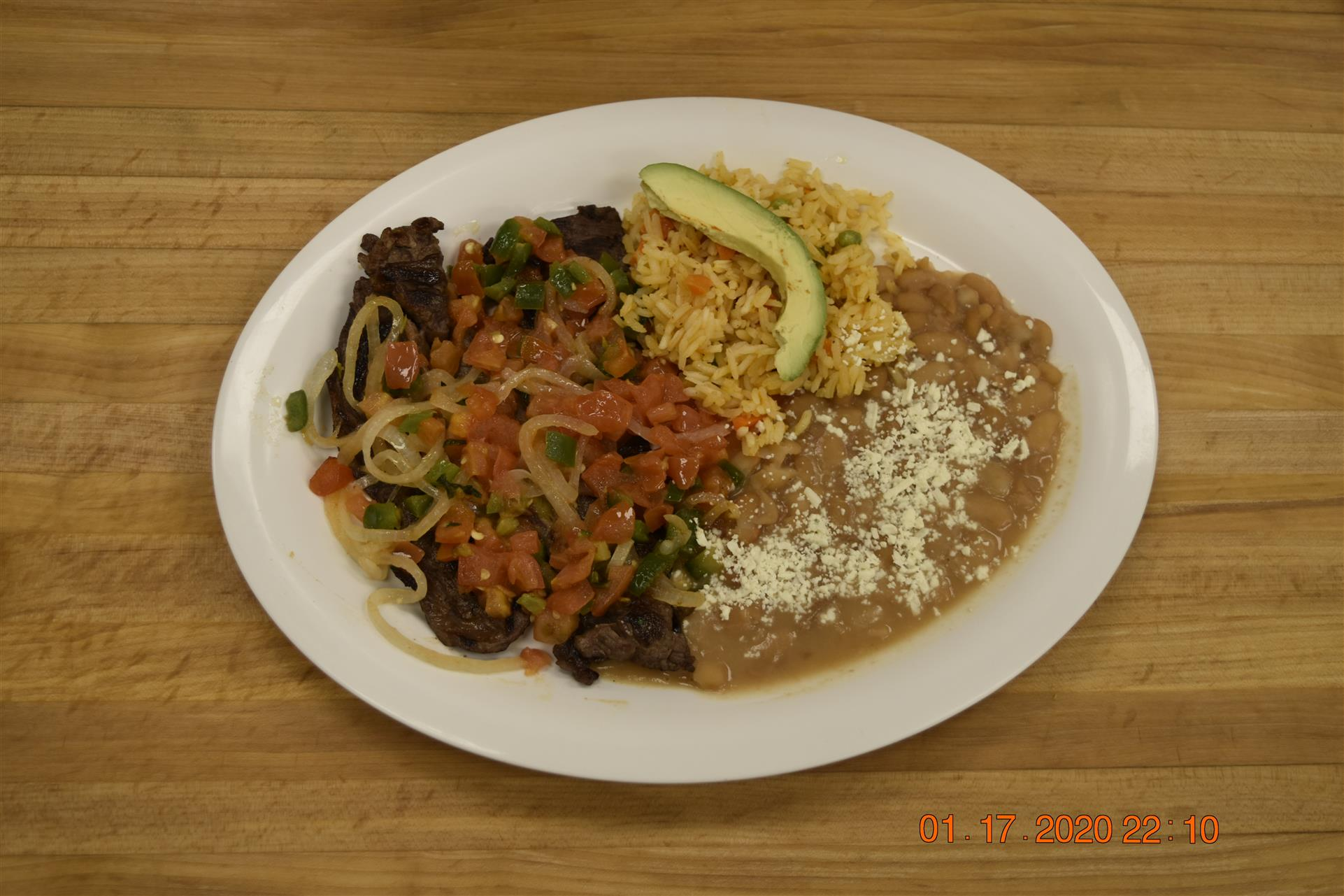 meat dish with side of rice and beans
