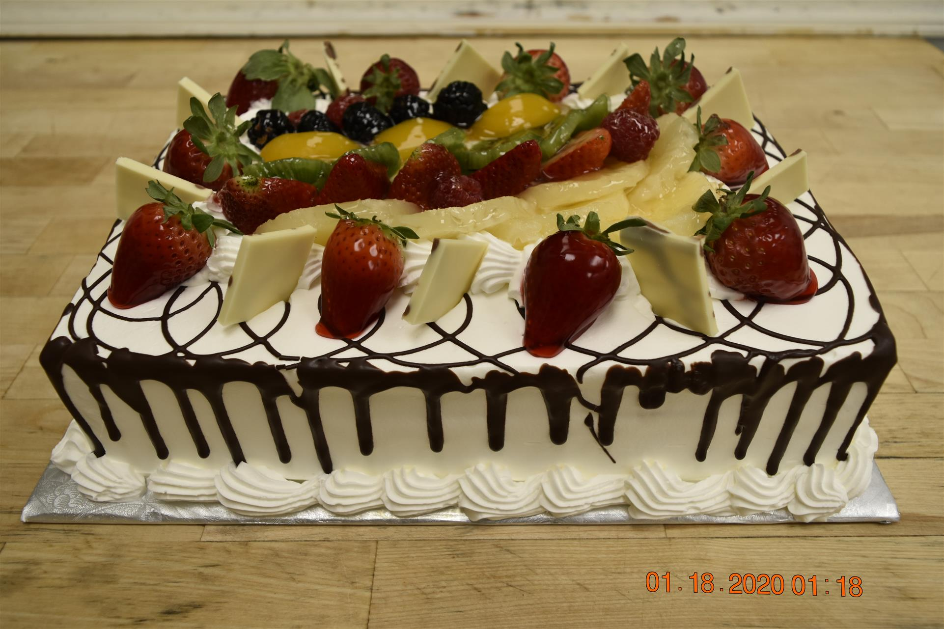 vanilla and chocolate cake with various fruits