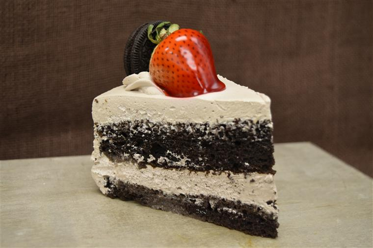chocolate mousse cake slice with a strawberry on top