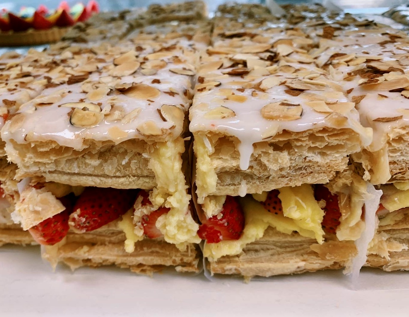 napolean cake slice with almonds and strawberries