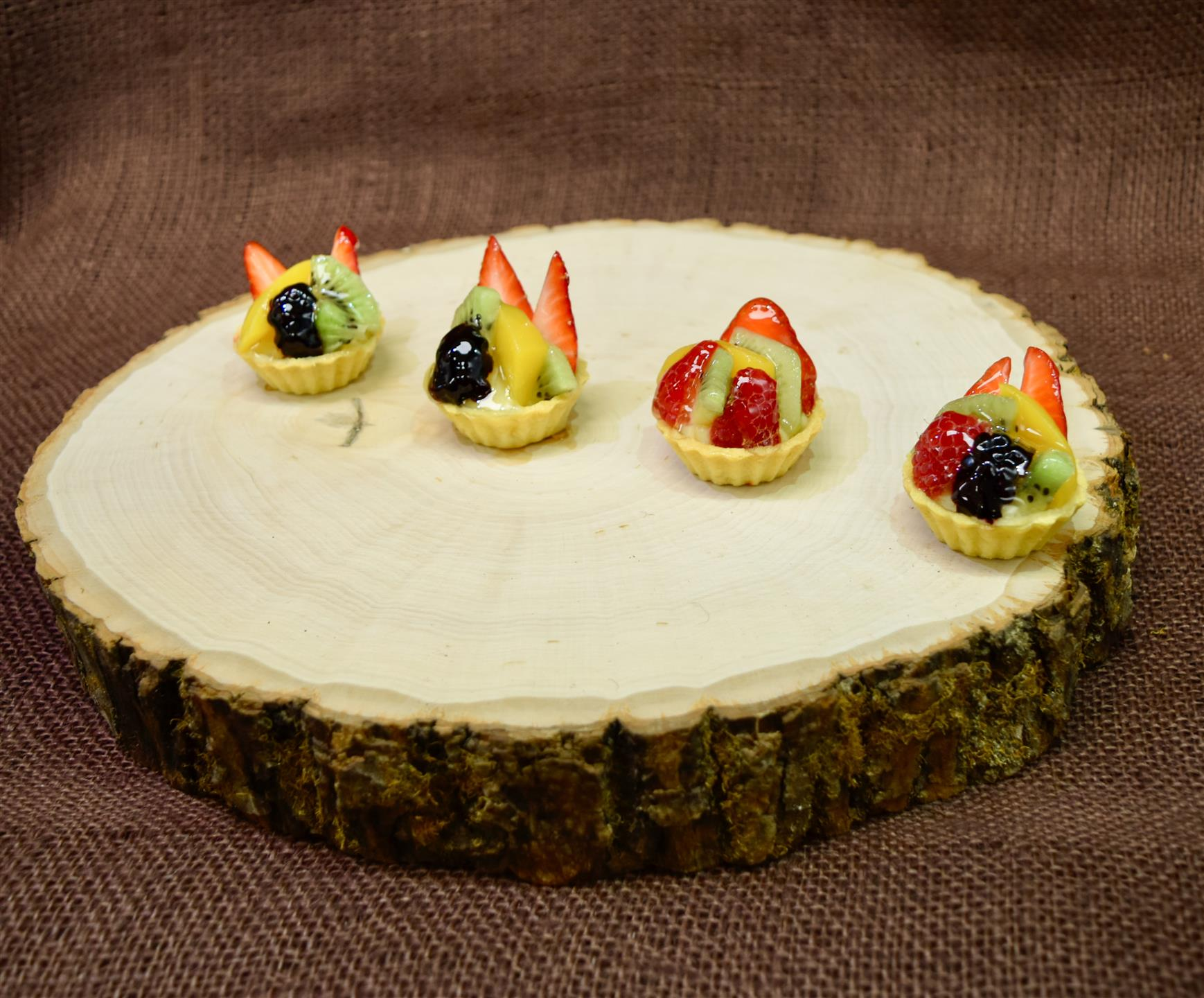 mini fruit tarts with assorted fruits and custard