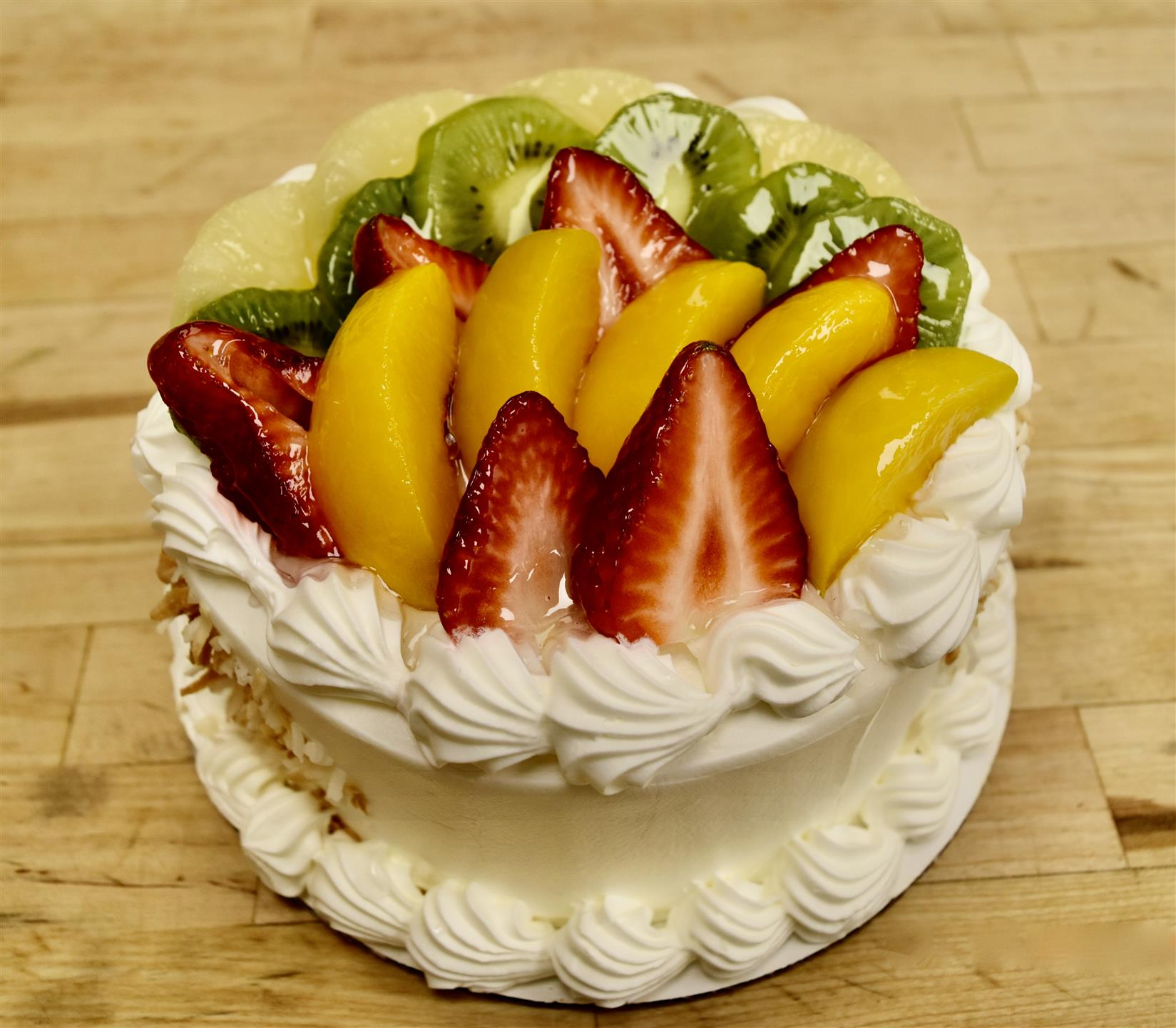 cake topped with kiwi and strawberries
