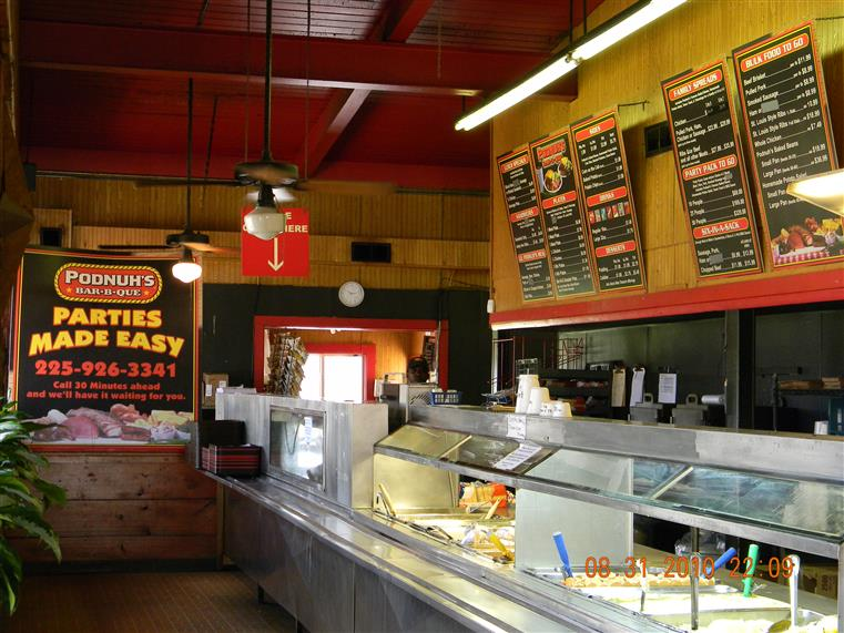 Ordering and service counter with menus on walls