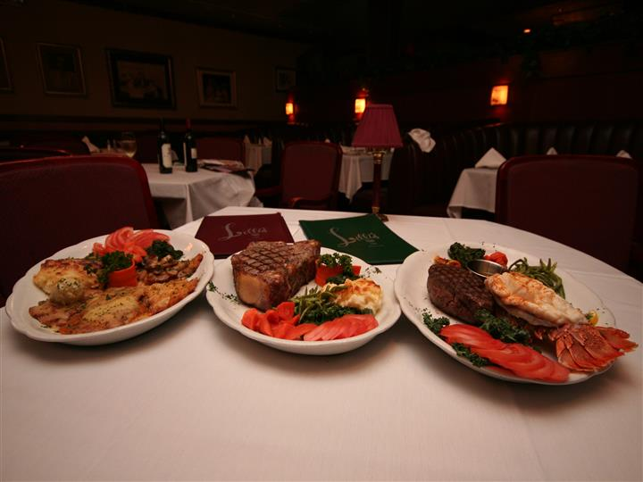 3 dishes woth seafood, steak, mashed potatoes, and spinach