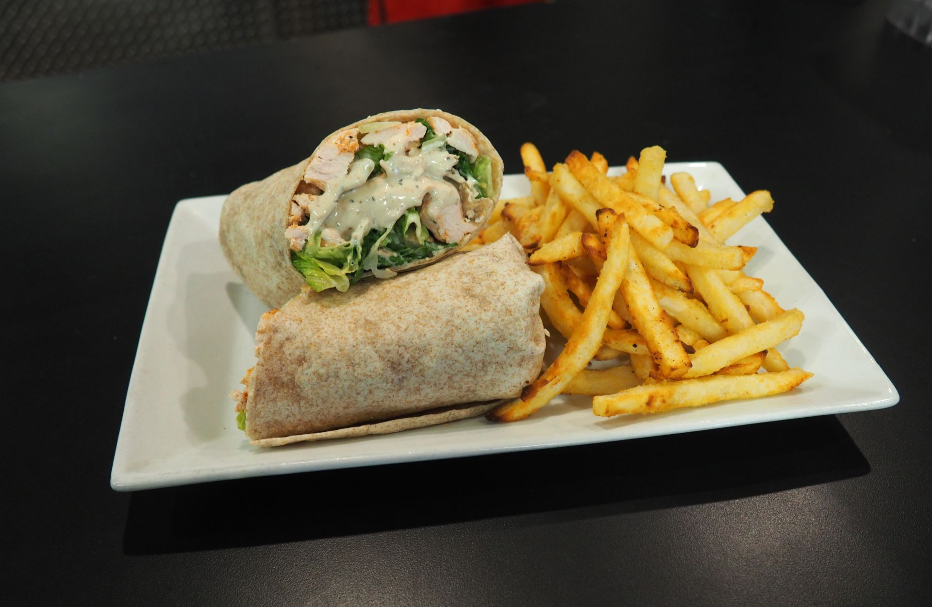 Grilled chicken Caesar wrap with French fries