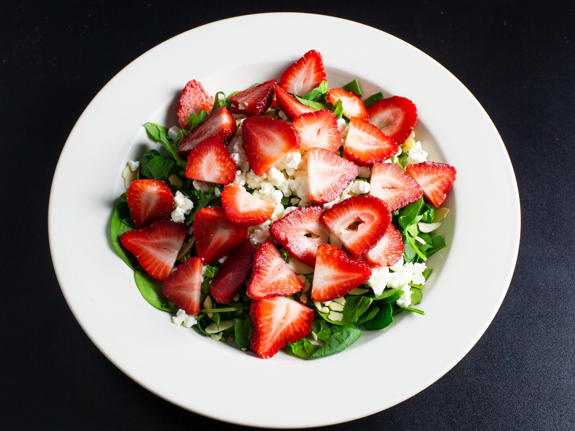 Strawberry and spinach salad with feta and sliced almonds