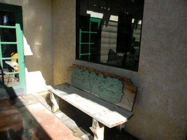 exterior front entrance with a bench