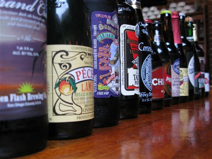 various beer bottles being displayed