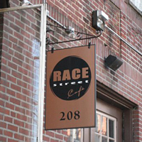 exterior sign with the race street cafe logo being displayed