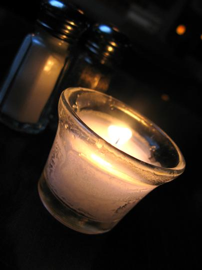 candle on one of the interior tables