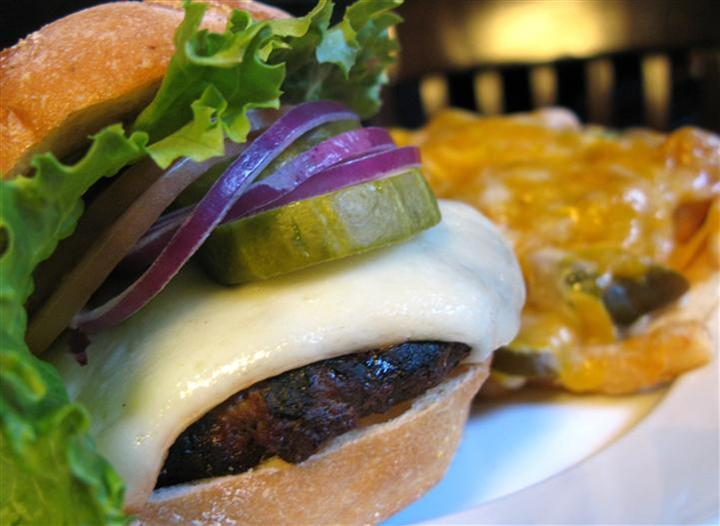 cheeseburger topped with onions and pickles
