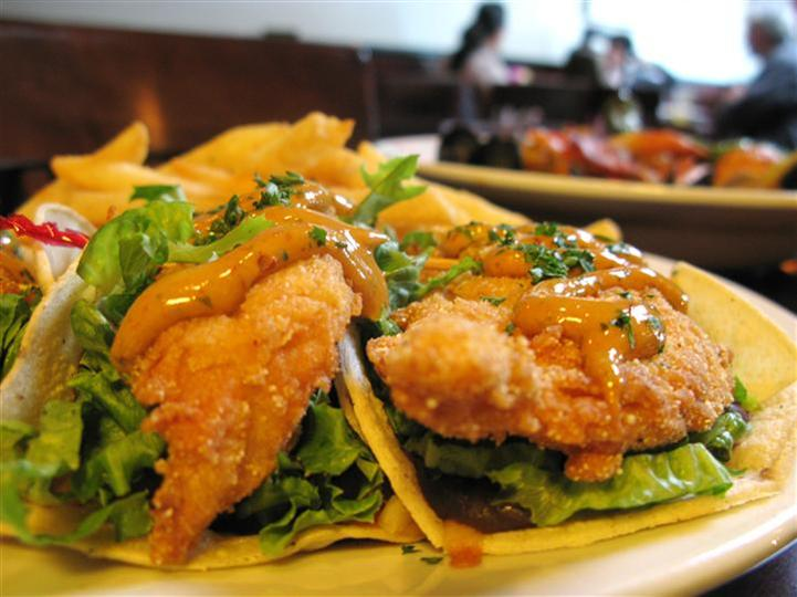 tacos filled with fried chicken and vegetables