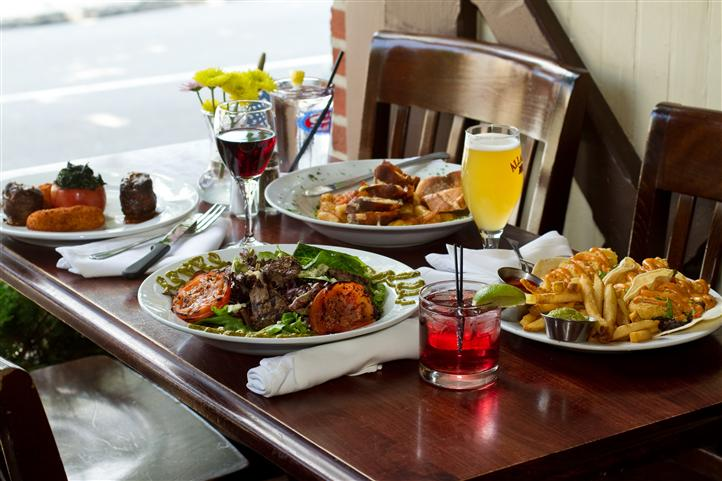 various entrees and drinks being displayed on a table