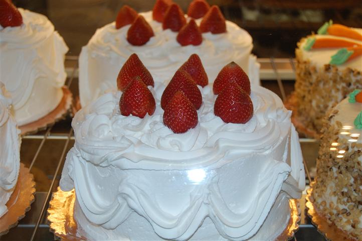 Cake with icing topped with strawberries