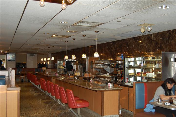 Bar area with chandeliers overhead