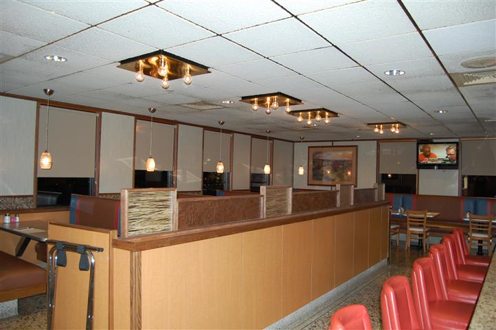 Dining area with chandeliers over head