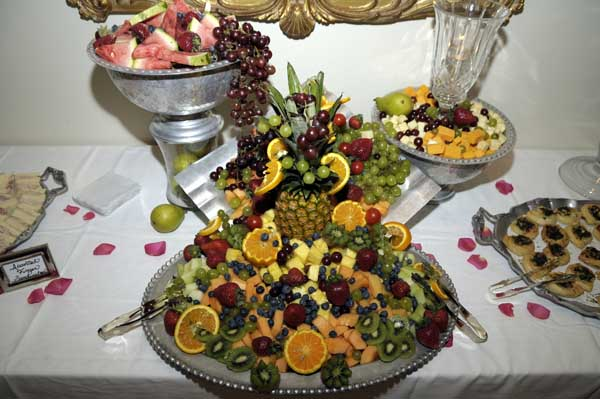 fruit display of sliced fruit on a metal platter