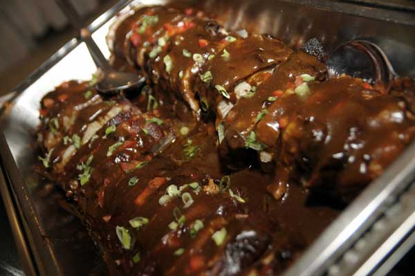 catering display of meatloaf with sauce and herbs