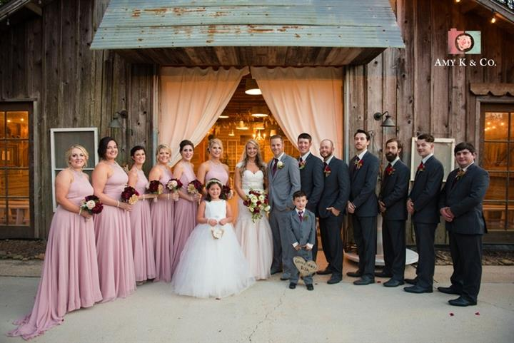 bridal party with bride and groom standing together for a group photo