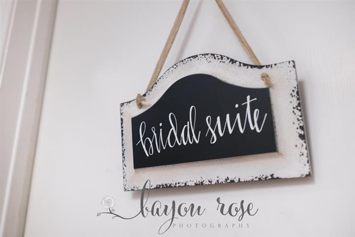sign hanging on a door that says bridal suite