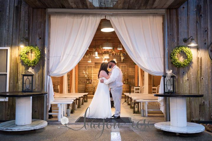 bride and groom indoors kissing taking a wedding photo together