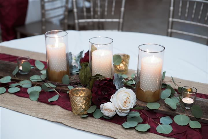 flower and candle centerpiece on a table