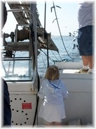 little girl looking over side of the boat