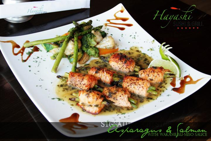 Hayashi Sushi & Grill promotional dish consisting of Asparagus and salmon