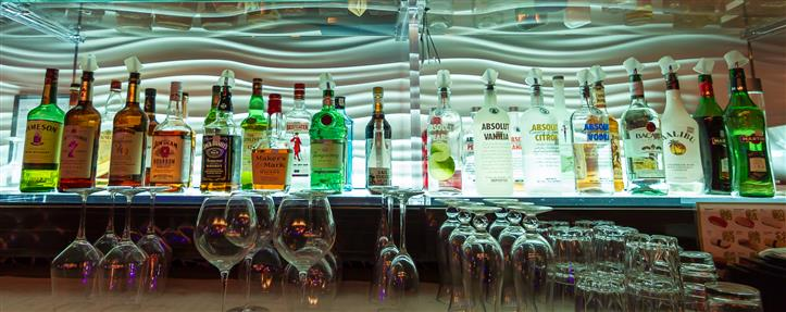 Bar area with rows of different liquor