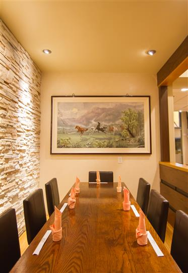 Dining area with a painting in the background