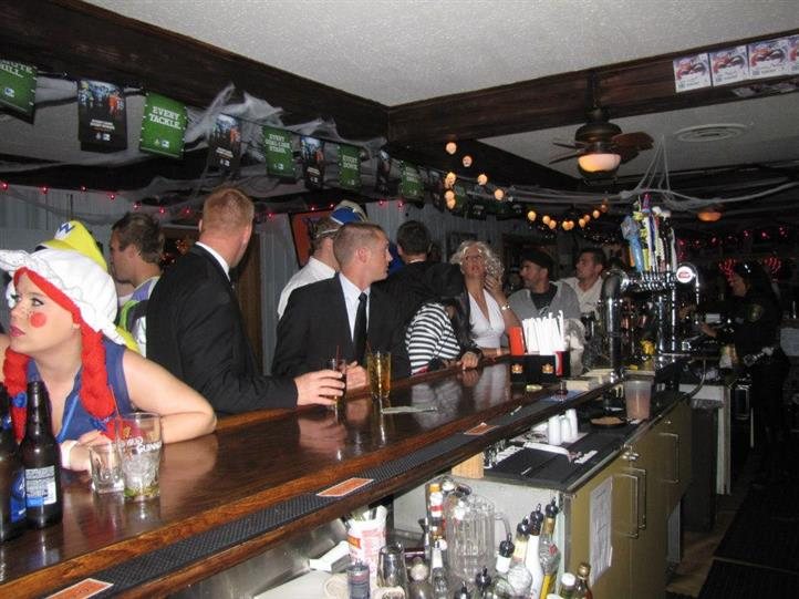 crowded bar area with customers having drinks