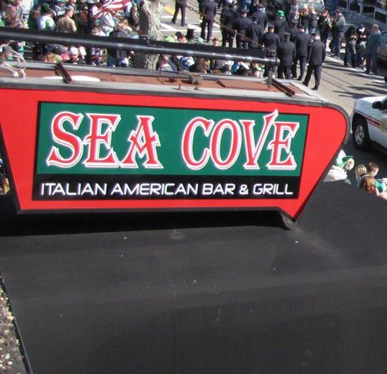 exterior signage to sea cove italian american bar & grill