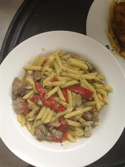 cooked pasta with vegetables and sausage